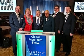 Secretary Pablos standing with individuals at the at the 2017 Global Petroleum Show in Calgary.