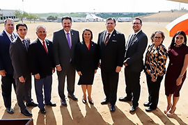 Secretary Hughs standing next to Laredo mayor Pete Saenz and other officials.